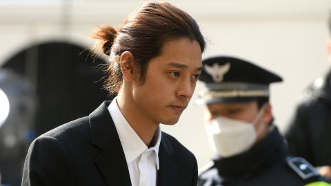 K-pop star Jung Joon-young (C) arrives for questioning at the Seoul Metropolitan Police Agency in Seoul on March 14, 2019. - A burgeoning K-pop sex scandal claimed a second scalp as a singer who rose to fame after coming second in one of South Korea's top talent shows admitted secretly filming himself having sex and sharing the footage. Jung Joon-young, 30, announced his immediate retirement from showbusiness amid allegations he shot and shared sexual imagery without his partners' consent. (Photo by JUNG Yeon-Je / AFP)        (Photo credit should read JUNG YEON-JE/AFP/Getty Images)