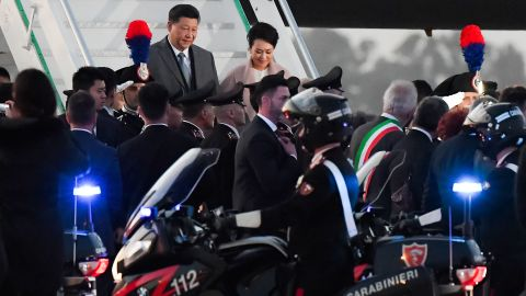 China's President Xi Jinping and his wife Peng Liyuan arrive in Rome on Thursday.