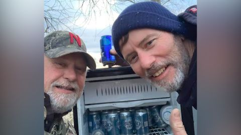 Kyle Simpson and Gayland Stouffer take a selfie with their beer discovery.