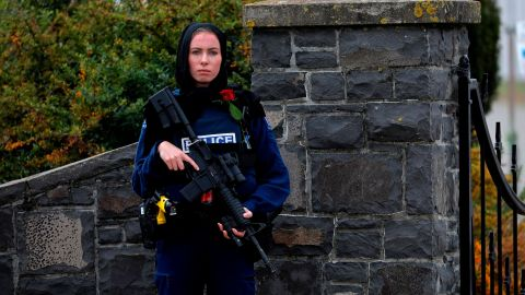 A police officer stands guard at the burial service for a victim of the mosque shootings in Christchurch, New Zealand.