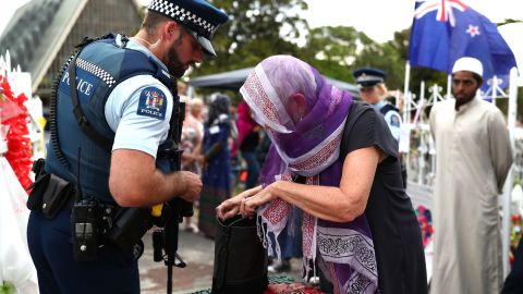 Police inspect bags of the guests arriving at the Ponsonby Masjid Mosque during an open service to all religions Friday in Auckland, New Zealand.