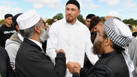 New Zealand All Blacks rugby player Sonny Bill Williams greets members of the Muslim community after attending Friday prayers near Al Noor mosque in Christchurch, New Zealand.