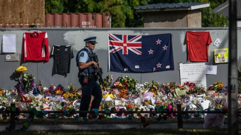 An armed police officer patrols near Al Noor mosque in Christchurch.