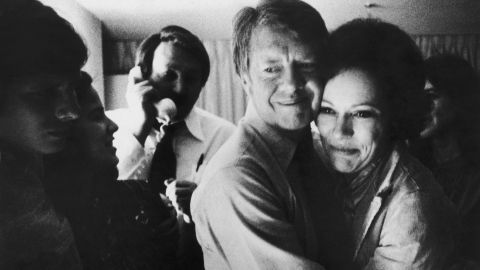 Carter embraces his wife after receiving news of his election victory on November 2, 1976. Carter received 297 electoral votes, while Ford received 241.