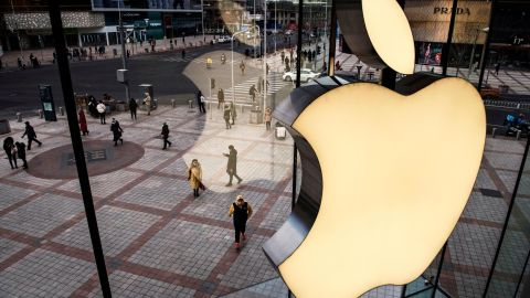 A logo on the window of an Apple Store in Beijing, China — a region where the company has struggled with device sales.