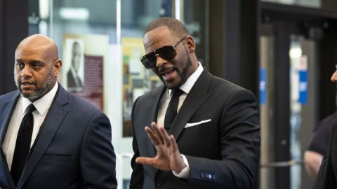 R. Kelly walks into the courthouse in Chicago on Friday morning ahead of his hearing.
