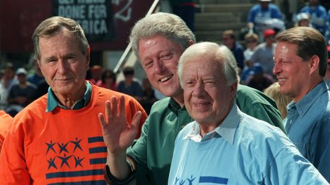 From left, former President George H.W. Bush, President Bill Clinton, Carter and Vice President Al Gore attend the Presidents' Summit for America's Future in Philadelphia in 1997. They helped clean up local neighborhoods as part of the effort to encourage volunteer service.