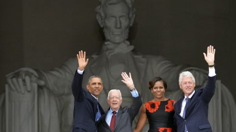 """From left, President Obama, Carter, first lady Michelle Obama and Clinton wave from the steps of the Lincoln Memorial on August 28, 2013. It was the 50th anniversary of the March on Washington, which is best remembered for Martin Luther King Jr.'s """"I Have a Dream"""" speech."""
