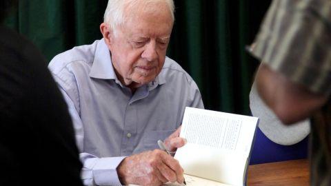 "Carter signs his book ""A Full Life: Reflections At Ninety"" in Pasadena, California, in July 2015."