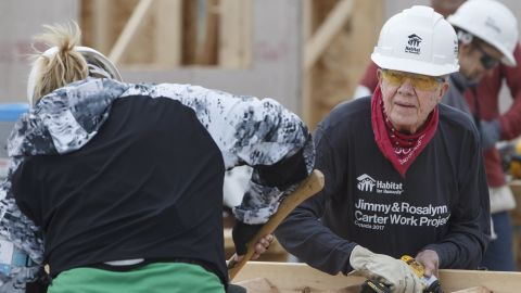 """Carter helps build stairs for a home during a Habitat for Humanity project in Edmonton, Alberta, in July 2017. A couple days later, while working on another house in Canada, <a href=""""http://www.cnn.com/2017/07/13/politics/jimmy-carter-dehydration-habitat-for-humanity/index.html"""" target=""""_blank"""">Carter became dehydrated</a> and was taken to a hospital as a precaution."""
