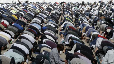 Muslims pray during Friday prayers at Hagley Park in Christchurch on March 22.