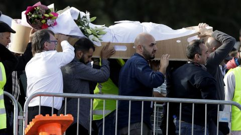 Mourners carry a body at Memorial Park Cemetery in Christchurch on March 22 as funerals continued a week after the deadly attacks.