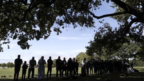 Muslim men pray in Hagley Park near Al Noor mosque in Christchurch, New Zealand, on Saturday, March 23. Most of the victims in the terror attacks died at that mosque.