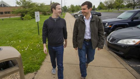 """Buttigieg walks with Facebook CEO Mark Zuckerberg, a personal friend, who was <a href=""""https://www.indystar.com/story/news/2017/05/01/why-facebook-ceo-mark-zuckerberg-hanging-out-south-bend-mayor-pete-buttigieg-and-elkhart-firefighters/101145566/"""" target=""""_blank"""" target=""""_blank"""">visiting South Bend</a> in April 2017."""