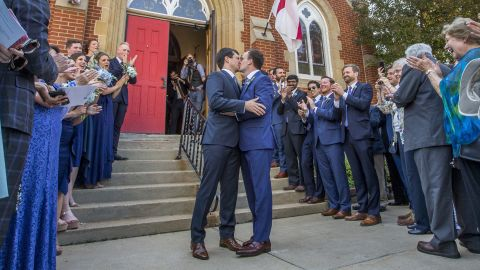 Buttigieg kisses his husband, Chasten, after they were married in South Bend in June 2018.