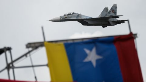 Russian-made Venezuelan Air Force Sukhoi Su-30MKV multirole strike fighters overfly a military parade to celebrate Venezuela's 206th anniversary of its Independence in Caracas on July 5, 2017.  Dozens of pro-government activists stormed into the seat of Venezuela's National Assembly Wednesday as the opposition-controlled legislature was holding a special session to mark the independence day. / AFP PHOTO / FEDERICO PARRA        (Photo credit should read FEDERICO PARRA/AFP/Getty Images)