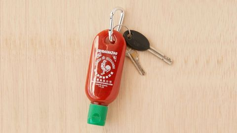 """<strong>For when you need to spice things up on the go</strong> Sriracha To-Go Bottle Keychain ($8; <a href=""""https://click.linksynergy.com/deeplink?id=Fr/49/7rhGg&mid=43176&u1=032250under15&murl=https%3A%2F%2Fwww.urbanoutfitters.com%2Fshop%2Fsriracha-to-go-bottle-keychain%3Fcategory%3DSEARCHRESULTS%26color%3D069"""" target=""""_blank"""" target=""""_blank"""">urbanoutfitters.com</a>)"""