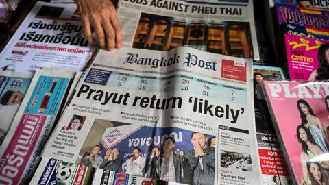 A vendor arranges newspapers at her newsstand in Bangkok on March 25, 2019 a day after Thailand's general election. - Thailand's ruling junta took an unexpected lead in the country's first election since a 2014 coup with more than 90 percent of ballots counted, election authorities said late March 24, putting it on course to return to power at the expense of the kingdom's pro-democracy camp. (Photo by Ye Aung THU / AFP)        (Photo credit should read YE AUNG THU/AFP/Getty Images)