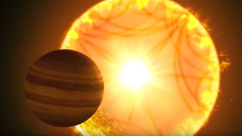 """A """"hot Saturn"""" passes in front of its host star in this illustration. Astronomers who study stars used """"starquakes"""" to characterize the star, which provided critical information about the planet."""