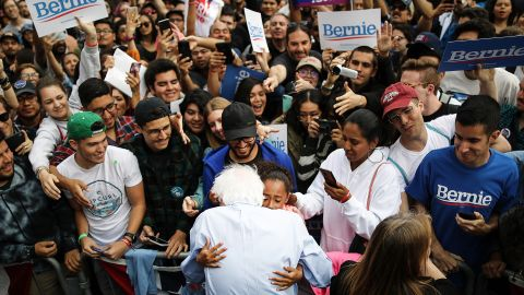 Sanders hugs a young supporter during a campaign rally in Los Angeles in March 2019.