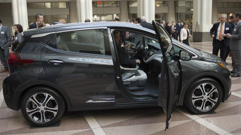 A man looks at a Chevrolet Bolt before attending a winter luncheon with Mary T. Barra, Chairman and CEO of General Motors Company in Washington, DC on February  28, 2017. / AFP / Andrew CABALLERO-REYNOLDS        (Photo credit should read ANDREW CABALLERO-REYNOLDS/AFP/Getty Images)