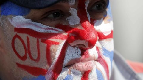 """A Brexit supporter wears the Union Jack colors on his face at Parliament Square in Westminster, London, Friday, March 29, 2019. Pro-Brexit demonstrators were gathering in central London on the day that Britain was originally scheduled to leave the European Union. British lawmakers will vote Friday on what Prime Minister Theresa May's government described as the """"last chance to vote for Brexit."""" (AP Photo/ Frank Augstein)"""
