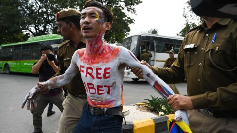 A Tibetan exile activist is detained by Indian police during a protest near the Chinese embassy in New Delhi on March 12.
