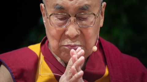 """Tibetan spiritual leader the Dalai Lama folds his hands prior to give a speech on September 20, 2018 in Heidelberg, western Germany. - The Dalai Lama is attending the International Science Festival where he is to give a speech on """"Happiness and Responsibility"""". (Photo by Marijan Murat / dpa / AFP) / Germany OUT        (Photo credit should read MARIJAN MURAT/AFP/Getty Images)"""