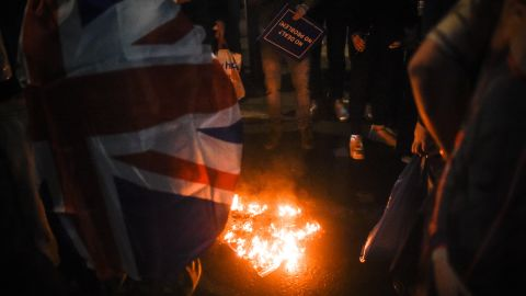 Pro-Brexit protesters burn an EU flag on Friday night in London.