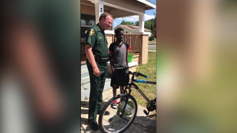 Polk County, Florida, Sheriff Grady Judd gives Daylin Campbell, 13, a new bike after his was stolen.