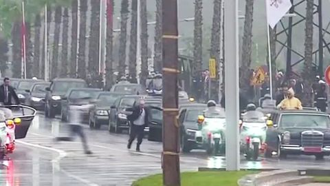 A still from a video shows the teen approaching the motorcade.