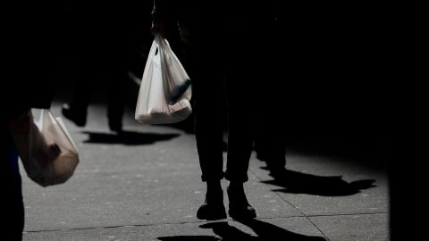 A New Yorker carries a plastic bag during lunch hour on January 15 in New York City.