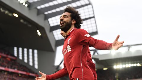 Liverpool's Egyptian midfielder Mohamed Salah celebrates after a late own goal from Tottenham Hotspur's Belgian defender Toby Alderweireld (not pictured) during the English Premier League football match between Liverpool and Tottenham Hotspur at Anfield in Liverpool, north west England on January 31, 2019. (Photo by Paul ELLIS / AFP) / RESTRICTED TO EDITORIAL USE. No use with unauthorized audio, video, data, fixture lists, club/league logos or 'live' services. Online in-match use limited to 120 images. An additional 40 images may be used in extra time. No video emulation. Social media in-match use limited to 120 images. An additional 40 images may be used in extra time. No use in betting publications, games or single club/league/player publications. /         (Photo credit should read PAUL ELLIS/AFP/Getty Images)