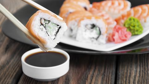 Salty foods, such as soy sauce eaten with sushi, contribute to high sodium levels in Asian diets.