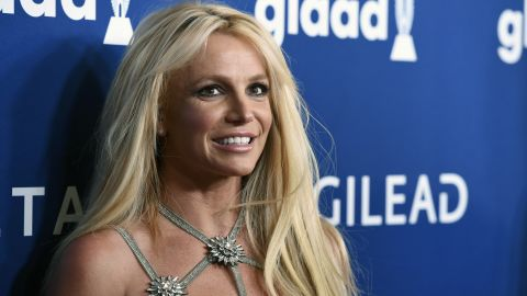 """FILE - This April 12, 2018 file photo shows Britney Spears at the 29th annual GLAAD Media Awards in Beverly Hills, Calif. Spears has decided to focus on self-care as she goes through a rough stretch. She posted an image on Instagram Wednesday with the words, """"Fall in love with taking care of yourself. Mind. Body. Spirit."""" People magazine reports that worries for her father and the need to help take care of him after a life-threatening colon rupture last year have continued to take a toll on the pop star. (Photo by Chris Pizzello/Invision/AP, File)"""