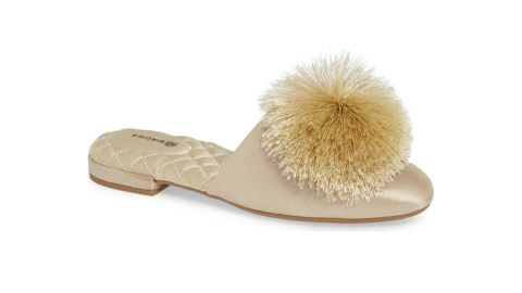 """<strong>The Songbird Slipper, Gold Satin ($140;</strong><a href=""""https://click.linksynergy.com/deeplink?id=Fr/49/7rhGg&mid=1237&u1=0405birdies&murl=https%3A%2F%2Fshop.nordstrom.com%2Fs%2Fbirdies-the-songbird-slipper-women%2F5105381%3Forigin%3Dcategory-personalizedsort%26breadcrumb%3DHome%252FWomen%252FShoes%252FSlippers%26color%3Dgold%2520satin"""" target=""""_blank"""" target=""""_blank""""><strong> nordstrom.com</strong></a><strong>)</strong>"""