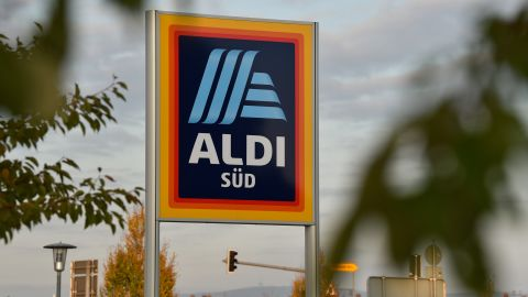 A sign with the new logo of the discount store Aldi placed in front of a branch in Schwetzingen, Germany, 03 November 2017. Photo: Sina Schuldt/dpa (Photo by Sina Schuldt/picture alliance via Getty Images)