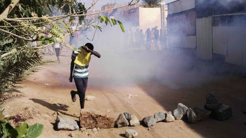 A protester retreats from tear gas during an anti-government demonstration on February 24.
