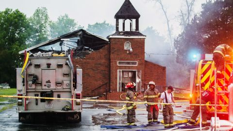 """Firefighters and fire investigators respond to a fire at Mt. Pleasant Baptist Church Thursday, April 4, 2019, in Opelousas, La. Authorities in southern Louisiana are investigating a string of """"suspicious"""" fires at three African American churches in recent days. Fire Marshal H. """"Butch"""" Browning said it wasn't clear whether the fires in St. Landry Parish are connected and he declined to get into specifics of what the investigation had yielded so far but described the blazes as """"suspicious."""" (Leslie Westbrook/The Advocate via AP)"""