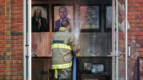 Firefighter battles blaze  at Mount Pleasant Baptist Church on Thursday.