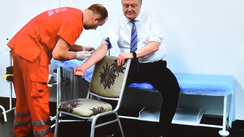 A TV screen made available for journalists to watch during a press conference, shows Ukrainian President Petro Poroshenko undergoing a blood test in a clinic of the Olimpiyski, the country's biggest stadium, in Kiev on April 5, 2019, to prove he does not abuse alcohol and drugs ahead of a second-round runoff on April 21. - Ukraine's incumbent leader, 53-years-old, is eager to spar with his political novice rival, giving him a chance to show off his debating skills and outflank comedian Volodymyr Zelensky, 41-years-old, before a run-off vote on April 21. But he had to agree to a number of unusual conditions set down by , including a requirement for both of them to undergo medical tests to prove they do not abuse alcohol or drugs. (Photo by Sergei SUPINSKY / AFP)        (Photo credit should read SERGEI SUPINSKY/AFP/Getty Images)