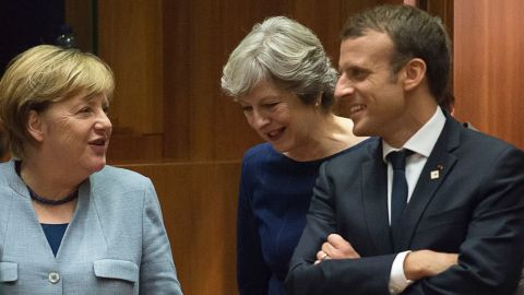 (From L) German Chancellor Angela Merkel, Britain Prime minister Theresa May and French President Emmanuel Macron talk as they arrive in Brussels, on October 19, 2017 during the summit of European Union (EU) leaders, set to rule out moving to full Brexit trade talks after negotiations stalled. / AFP PHOTO / JOHN THYS        (Photo credit should read JOHN THYS/AFP/Getty Images)