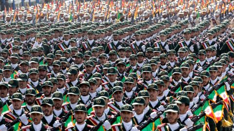 In this Friday, Sept. 21, 2012 file photo, Iran's Revolutionary Guard troops march during a military parade commemorating the start of the Iraq-Iran war 32 years ago, in front of the mausoleum of the late revolutionary leader Ayatollah Khomeini, just outside Tehran, Iran.
