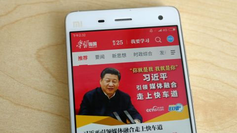 """This photo illustratration from February shows a phone app called """"Xuexi Qiangguo"""" or """"Study to make China strong"""" with an image of China's President Xi Jinping in Beijing."""