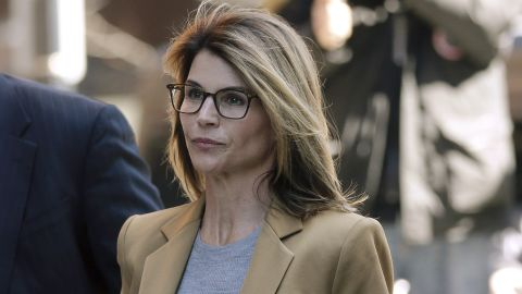 Lori Loughlin arrives at federal court in Boston on Wednesday, April 3, 2019, to face charges in a nationwide college admissions bribery scandal. (AP Photo/Steven Senne)