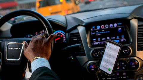 NEW YORK, NY - AUGUST 8: After dropping off passengers at a Broadway play, Johan Nijman, a for-hire driver who runs his own service and also drives for Uber on the side, drives through the West Side of Manhattan on Wednesday evening, August 8, 2018 in New York City. On Wednesday, New York City became the first American city to halt new vehicles for ride-hail services. The legislation passed by the New York City Council will cap the number of for-hire vehicles for one year while the city studies the industry. The move marks a setback for Uber in its largest U.S. market. Nijman, a member of the Independent Drivers Guild who has been driving in various capacities since 1991, says the temporary vehicle cap is a good start but he would like to see the city do more to deal with the over-saturation of vehicles and new drivers. (Photo by Drew Angerer/Getty Images)