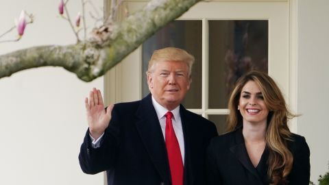 US President Donald Trump poses with former communications director Hope Hicks shortly before making his way to board Marine One on the South Lawn and departing from the White House on March 29, 2018. (MANDEL NGAN/AFP/Getty Images)