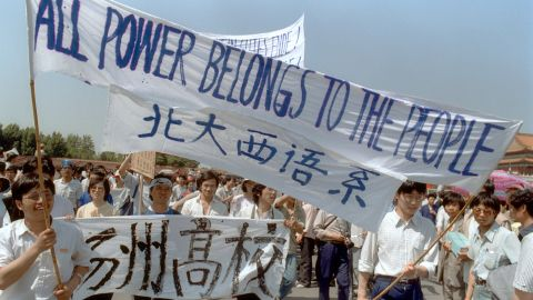 BEIJING, CHINA - MAY 25:  Waving banners, high school students march in Beijing streets near Tiananmen Square 25 May 1989 during a rally to support the pro-democracy protest against the Chinese government. The April-June 1989 movement was crushed by Chinese troops in June when army tanks rolled into Tiananmen Square 04 June.  (Photo credit should read CATHERINE HENRIETTE/AFP/Getty Images)