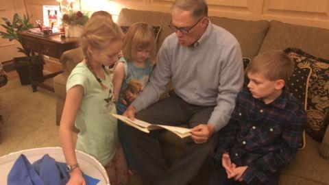 Washington Gov. Jay Inslee reads to his grandchildren.