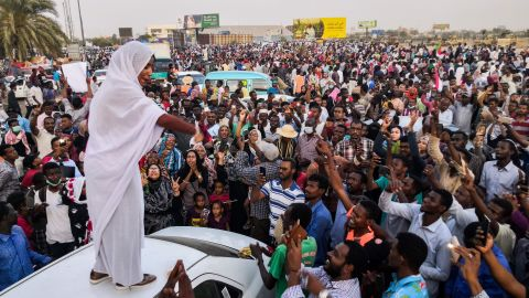 """Salah, the woman <a href=""""https://www.cnn.com/2019/04/10/middleeast/sudan-woman-iconic-photo-revolution-intl/index.html"""" target=""""_blank"""">propelled to internet fame</a> after clips of her leading protest chants went viral, addresses protesters on April 10."""